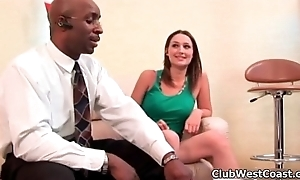 Sexy brunette babe jerks a black dick