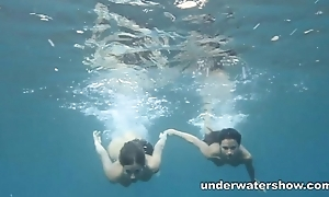 Julia and Masha are swimming nude in sonorous