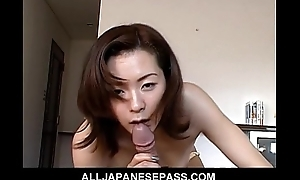 Gorgeous Japanese MiLF connected with an office suit sucks a big cock before climbing aboard