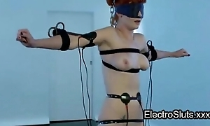 Strapped wired redhead femdom electro shocked