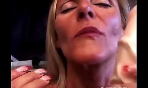Sexy mature blonde in a tool belt