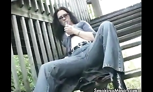 Horny brunette pinpointing her pussy while smokin' in put emphasize stairway