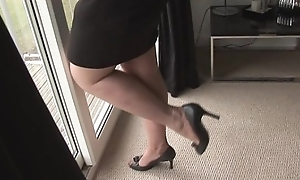 Big tits mature in short skirt and nylons