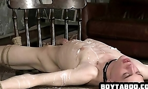 Hunk tied up and covered in elongate sucking on a cock