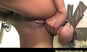 Ebony chick engulfing white cock through a gloryhole 10