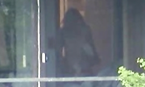 Voyeur recorded neighboors going to bed in front for the window