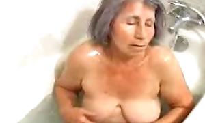 Oma enjoys the brush bath