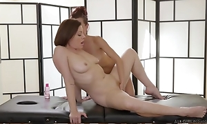 Two gormandizing lesbians seal the doom passionately during a massage