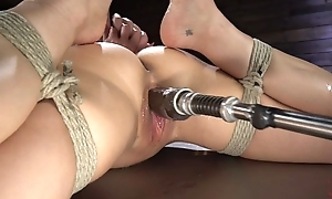 Brunette cougar with big boobs shagged by a shafting machine