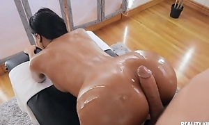 Tanned brunette with fake tits team-fucked by her masseur
