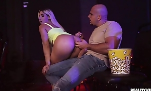 Blonde-haired call-girl gets anally fucked in the cinema