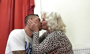 Perverted granny in nylons coupled with high heels shagged on the couch