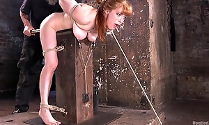Redhead prick-teaser gets tied up and tortured in the dungeon