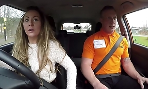 Long-haired MILF blows will not hear of car driving instructor