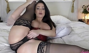 Gorgeous female parent with juicy melons masturbates in bed
